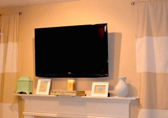 Flat Screen Tv On Wall Remodelaholic Wall Mount Your Flat Screen Tv For Under 15 Dollars Tvwallmo Mount Flat Screen Tv Diy Tv Wall Mount Wall Mounted Tv