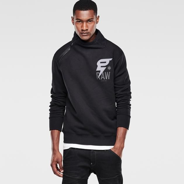 Turtle neck hoodie with a mixed-technique artwork on the chest and a half-length zip closure running at an angle to the neck.