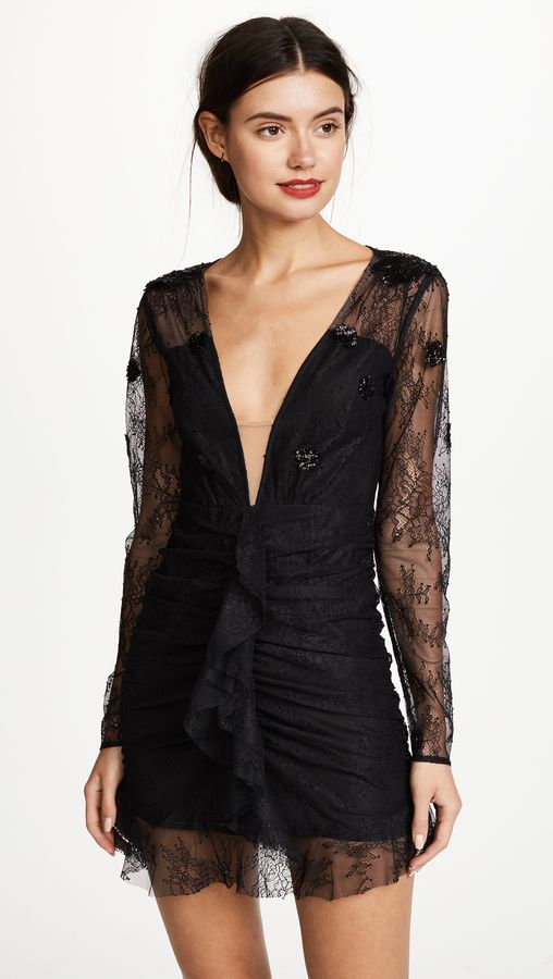 Black lace long sleeve dress with deep v neck - this is a great holiday party dress for petite gals. For Love & Lemons Daisy Lace Mini Dress