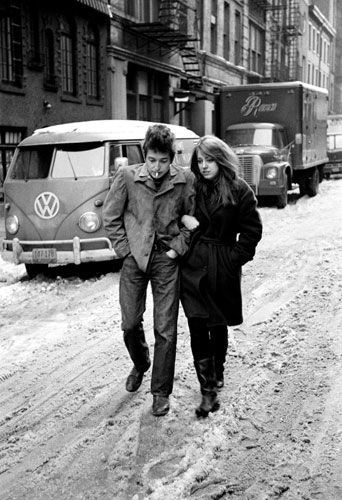 "Photograph: Outtake from the ""The Freewheelin' Bob Dylan"" cover sessions. Bob walking with Susan Elizabeth ""Suze"" Rotolo – February, 1963, taken by CBS staff photographer, Don Hunstein"
