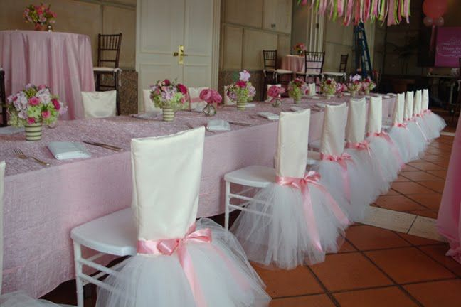 tulle party favors around chairs. each girl can embellish with ribbon or flowers as a craft.