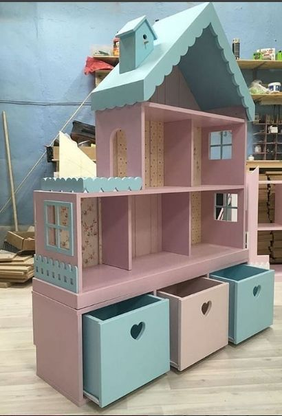 Awesome Ikea hack dollhouse with storage drawers below