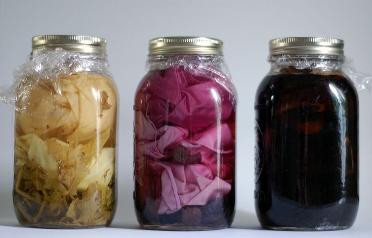 Solar dying is a simple and non-toxic way to give color that is directly related to the plant matter involved and the season it was gleaned, such as tomato and mint leaves, concord grapes, and black walnut hulls mixed along with alum and distilled water. A larger container like for sun tea could also be used for bigger items.: