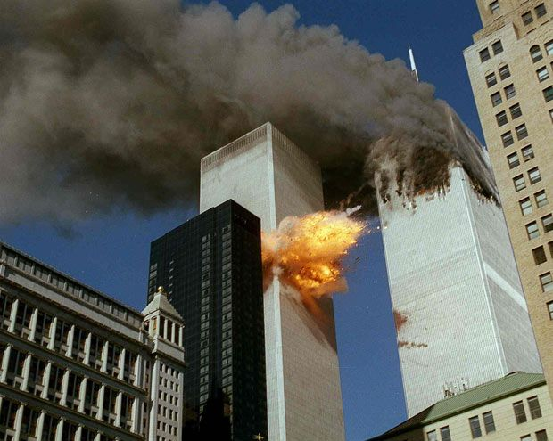 United Airlines Flight 175 collides into the south tower of the World Trade Center in New York as smoke billows from the north tower. (AP Photo/Chao Soi Cheong