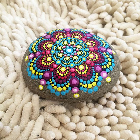 This stone was found on a walk of White Point on Cape Breton Island. It was hand picked for its smooth and circular appearance, created perfectly by nature - each stone has a note from the location it was collected from. It is hand-painted with acrylic paint and protected with a matte