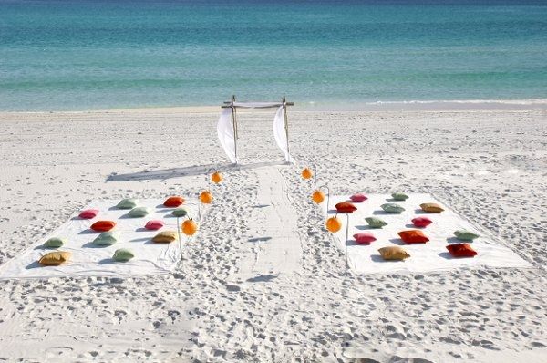modern beach wedding... i don't necessarily like the idea of people sitting on pillows, but i love the simplicity of this.
