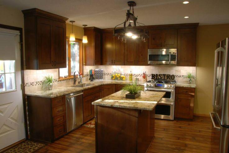 Knotty alder cabinets, granite, backsplash, flooring, lighting.