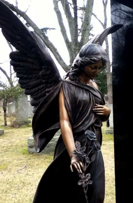 Love this unique angel with black wings and a beautiful rose in her hands!