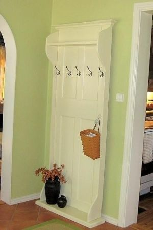 Old door turned coat rack! I love this because it's flat to the wall for small spaces. - good mudd room idea