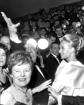 """Alfred Hitchcock casts a spell at the Cannes Film Festival with his wife, Alma Reville, and actress Tippi Hedren to promote """"The Birds"""" on May 11, 1963. Photo: RDA/Getty Images, May 11, 1963"""