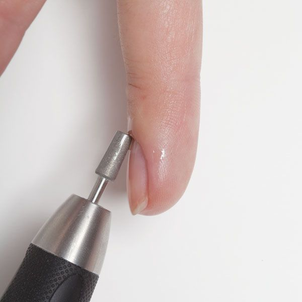 Avoid touching the nail plate with the bit. | How to use an e-file for natural nail prep; see the video tutorial at http://www.nailpro.com/workshop-clean-sweep