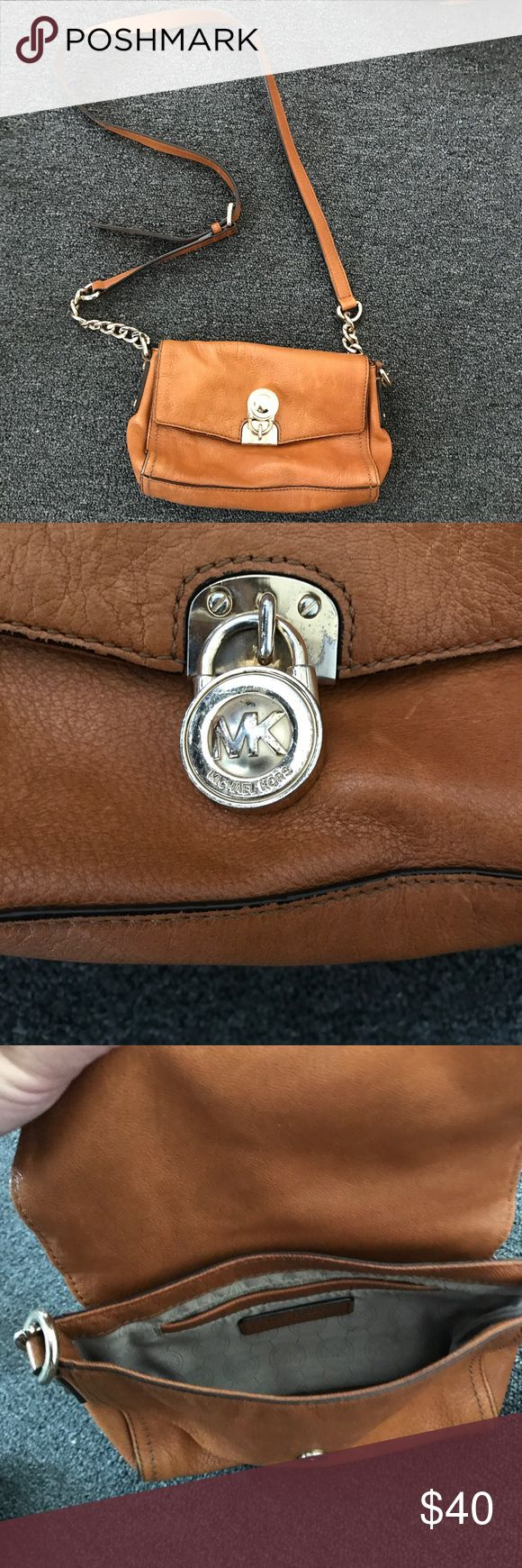 Michael kors Hamilton small messenger bag Michael Kors Hamilton small messenger bag in luggage brown. Preowned bag. The gold coloring is coming off slightly on the lock and clasp but otherwise in excellent condition. Has a lot of life left in it Bags Crossbody Bags