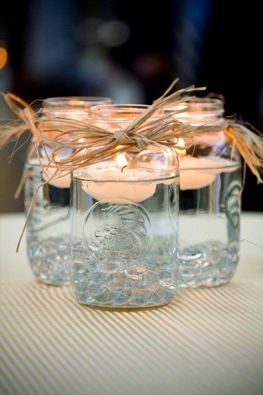 Floating candles in mason jarsIdeas, Floating Candles, Teas Lights, Mason Jar Centerpieces, Mason Jars Centerpieces, Mason Jar Candles, Mason Jars Candles, Tea Lights, Center Pieces