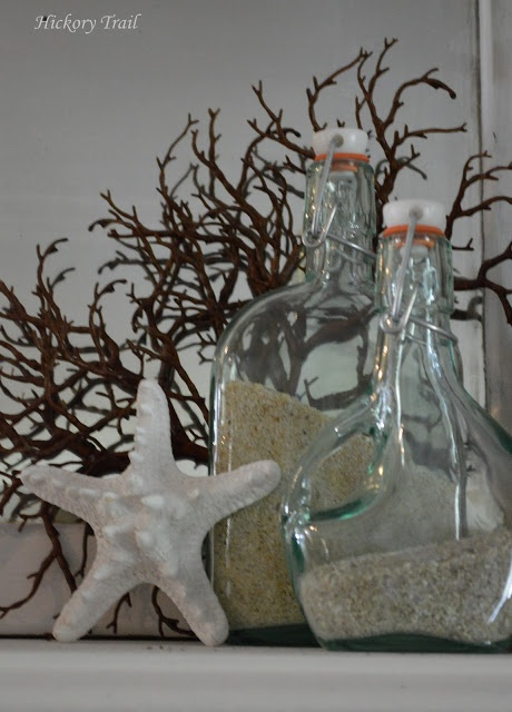 Summer decor: sand in pretty bottles and a star fish at Hickory Trail