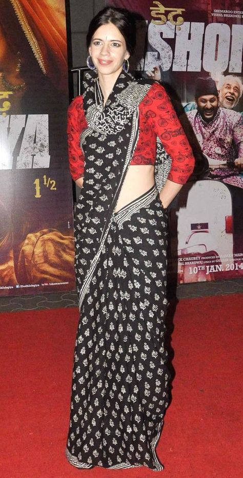 Kalki in black and white sari off set with a red and a black blouse