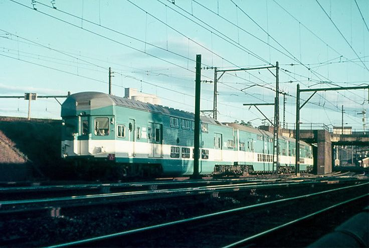 C3844 leads an all blue & white set on the down suburban line at Strathfield