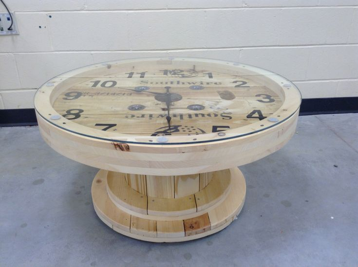 A cable wire spool made into a coffee table clock.