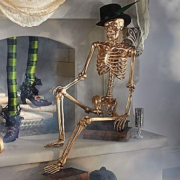 Get a dollar store skeleton and spray paint him gold and toss a top hat on him for a classy halloween prop