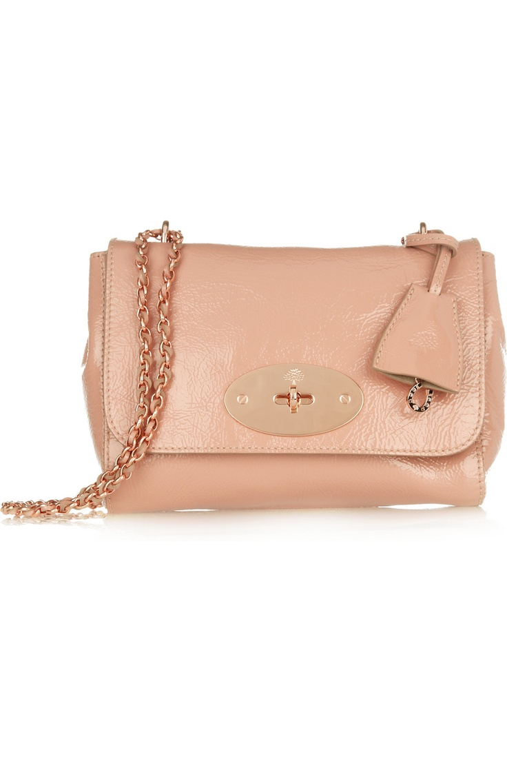 "I'm smitten with this pink patent leather handbag with girly rose gold hardware. Mulberry's ""Lilly"" is the perfect arm candy. Yum."