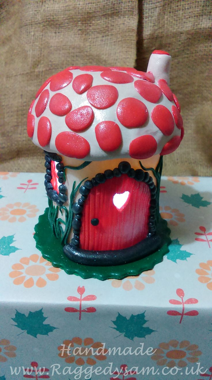Fairy house night light, made using polymer clay to coat a glass jar, a battery operated tea light candle is used to give a pretty lighting effect.