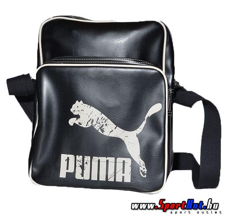Puma Originals Flight Bag fekete - fehér puma oldaltáska, koptatott Puma lógóval az elején. Két cipzáras rekesz és egy belső cipzáras zsebbel. Állítható hosszúságú vállpánt.