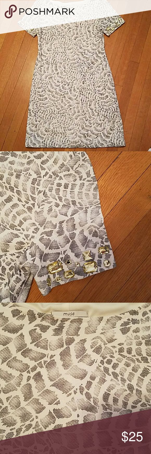 Shorts sleeve embellished knit shift dress Short sleeve animal print knit dress. 95% polyester 5% spandex with assorted size crystals on sleeves. 33 inches from shoulder to hem. Print has subtle shimmer. muse Dresses Mini
