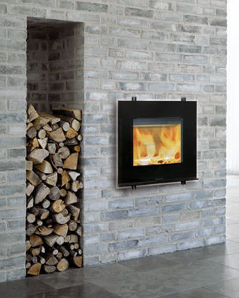 contemporary built-in wood-burning stove  - I love the recessed space in the wall for the wood