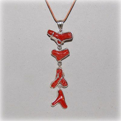 Authentic red coral individual pieces made into an impressive pendant. Entirely handmade in our workshop.