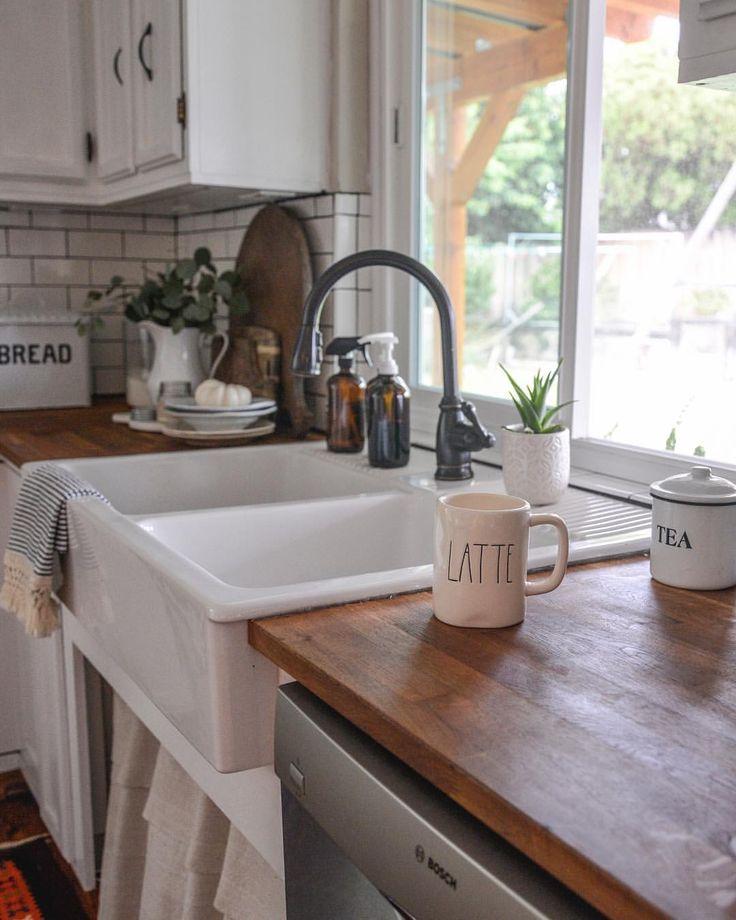 Farmhouse Apron Front Sink, Butcher Block Countertops, Subway Tile. Vintage Industrial Kitchen