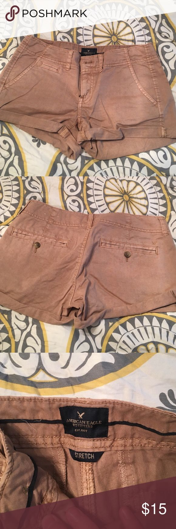 American Eagle khaki shorts American Eagle khaki shorts. Size 4. Only been worn once for family pictures. They don't fit anymore. In great condition. Little wrinkled due to sitting in drawer. American Eagle Outfitters Shorts