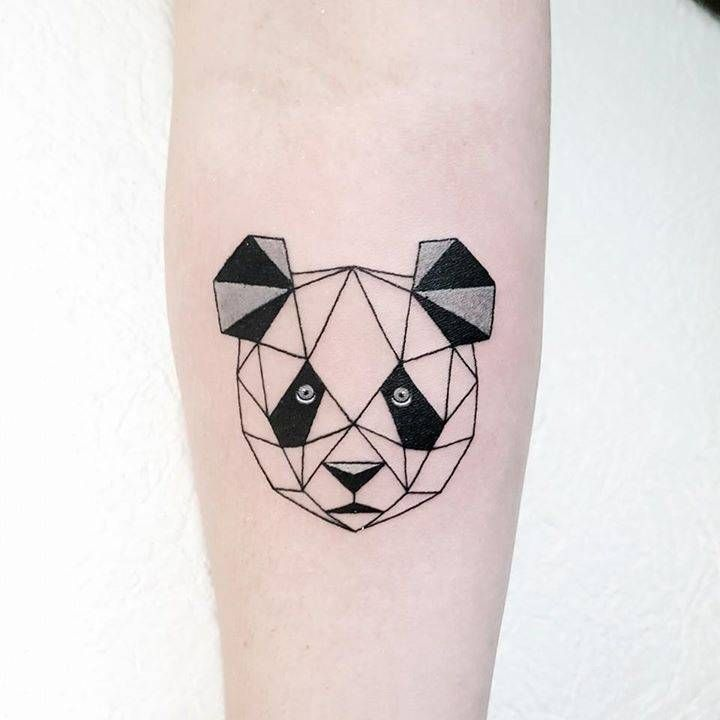 Polygonal panda bear tattoo on the right inner forearm. Tattoo artist: Pablo Díaz Gordoa
