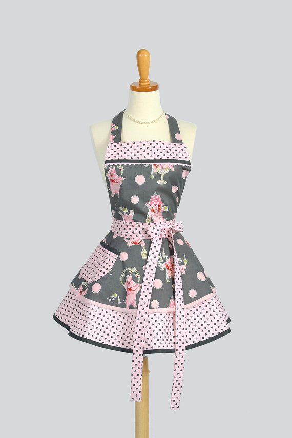 Cute and sassy ruffle apron is full of whimsical pink elephants sipping and…