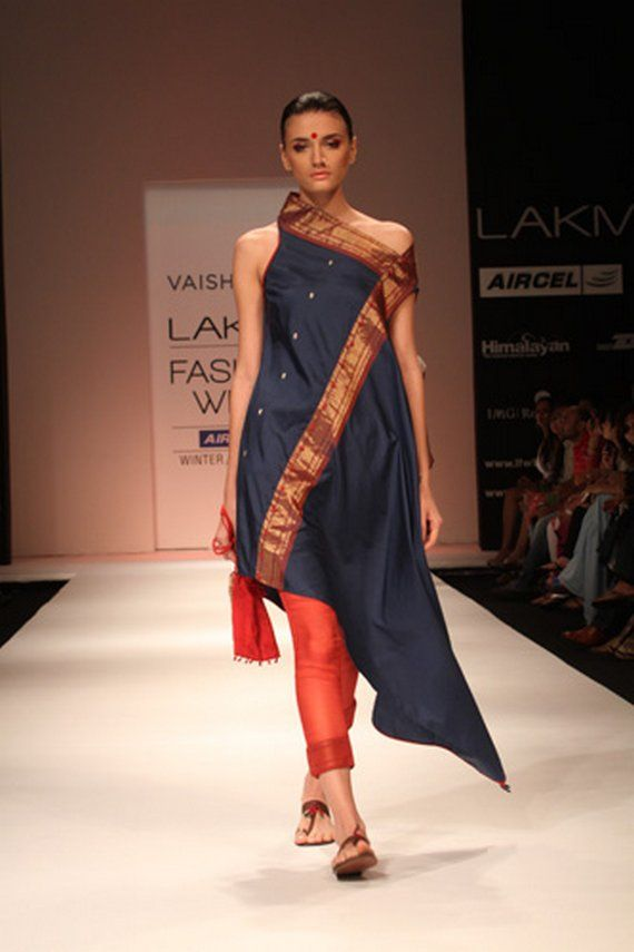A saree that is not a saree : this off-the-shoulder tunic dress puts the embroidery up front on this upcycled sari.