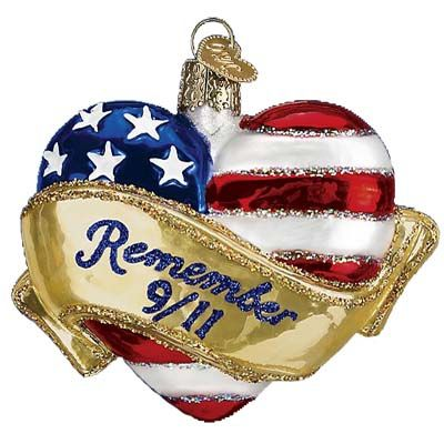 Remembrance Heart - Old World Christmas Hang Tag Reads: This glass Remembrance Heart ornament was designed to honor the thousands who lost their lives on September 11, 2001. The heart is wrapped with red, white and blue, the colors of the flag of the United States of America. The Remembrance Heart stands for courage, unity and love of country.