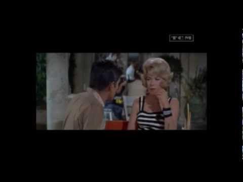 Η Κατίνα Ρανιέρι ερμήνευσε πρώτη το Forget Domani στην ταινία The Yellow Rolls-Royce (1964) σε σκηνές όπου χόρευαν η Shirley MacLaine και ο Alain Delon που λέγεται είχαν ένα ειδύλλιο στη διάρκεια των γυρισμάτων στην Ιταλία. Το τραγούδι έγινε ακόμη περισσότερο γνωστό χάρη στην αγγλική version από τον Frank Sinatra, Let's forget about tomorrow.     ...