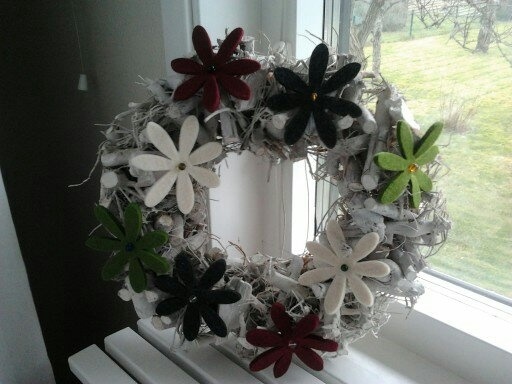 White painted a bought wreath and put some, also bought, felt flowers on it.