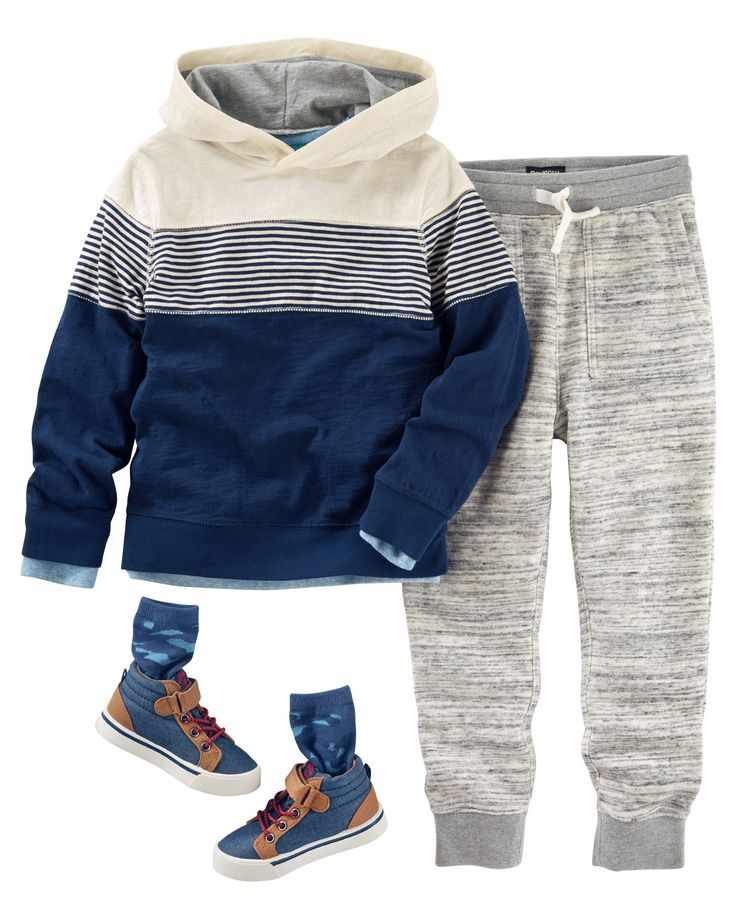 He plays it cool in a hooded tee and joggers. Plus, camo socks and high tops keep his style fresh and fun.