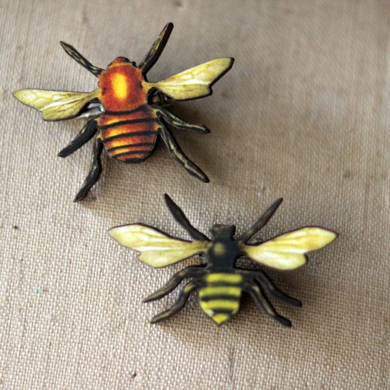 Honey Bee brooch set. One is 1.7 and 1.3 Made from wood and paper with a brass pin back. This listing is for 2 TWO brooches.  BIN 62