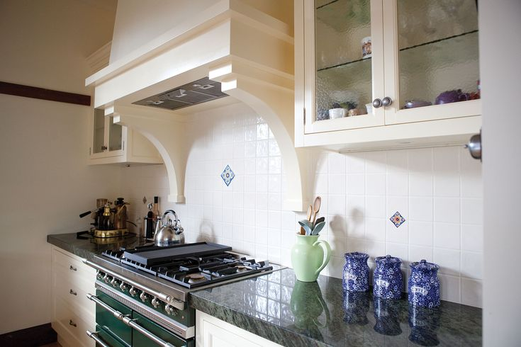 Green Lacanche In Kitchen With Split Level Island