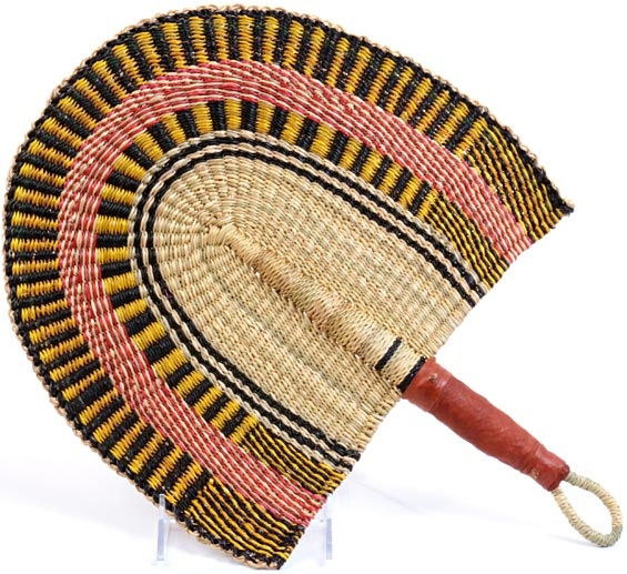 Hand fan from Ghana. Weavers in the region use the abundant Vetavera grass to weave these useful fans.