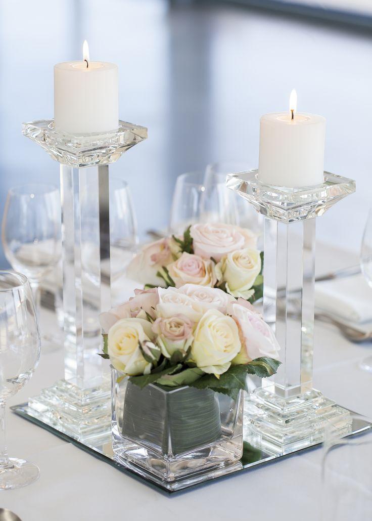 Centrepiece     Crystal candle holders with fresh floral      Wedding reception     Wedding centrepiece     Wedding styling     Wedding decor