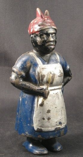 """An antique Black Americana """"Mammy"""" cast iron coin bank made in the USA by A.C. Williams Company. This coin bank dates to 1905 to the 30's."""