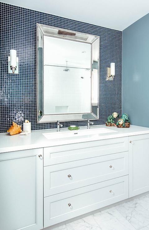 bathroom vanity white quartz countertop marble tiles floor gray   Light gray bath vanity cabinets donning glass pulls sit on ...