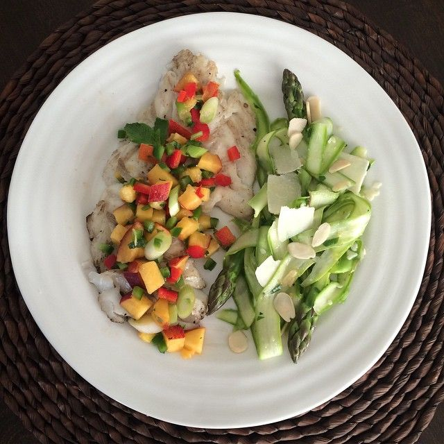 A delicious lime-infused nectarine mint salsa tops grilled wild haddock, served with a shaved asparagus salad in a lemony vinaigrette with parma and toasted almonds. #TGIF @zimmysnook