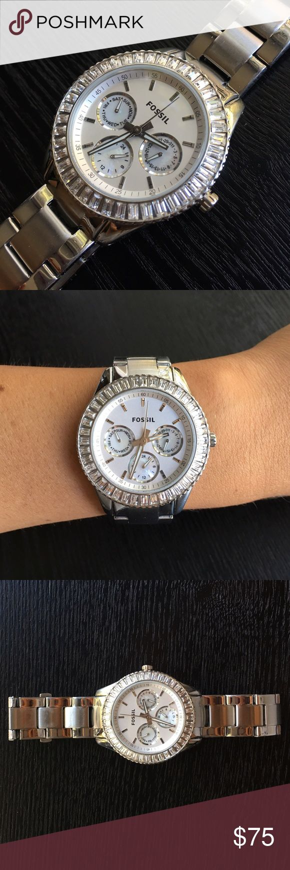 Women's Fossil Watch Pre-loved women's Fossil watch. Shiny silver & stainless steel. Chronograph are mother of pearl. Minor scratches from wear, nothing noticeable. Needs replacement battery. No extra links. Fossil Accessories Watches