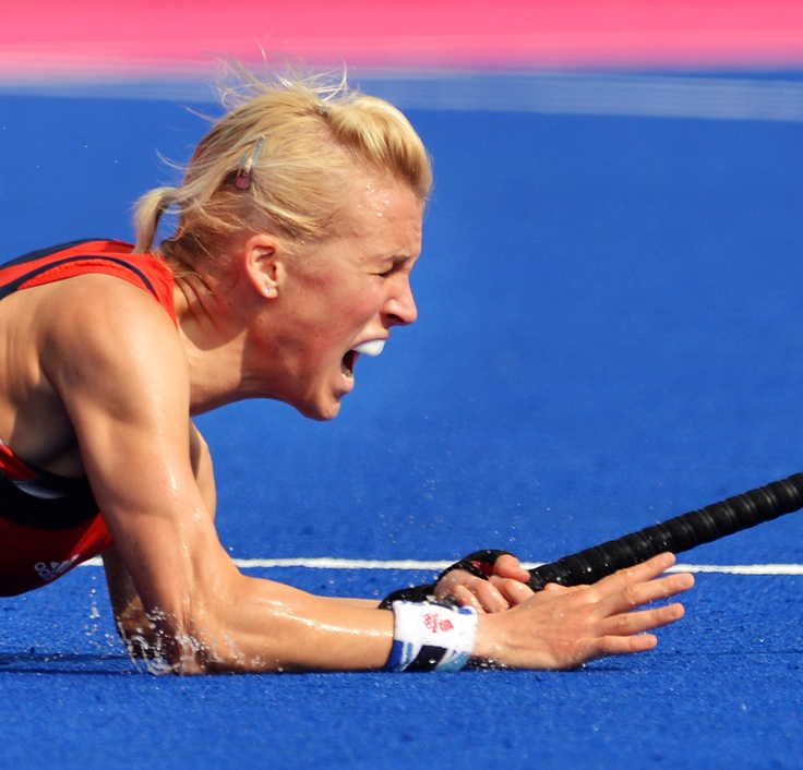 Alex Danson (15)  dives to the ground after scoring her goal for Great Britain. This pictures shows the passion she felt after scoring that goal.