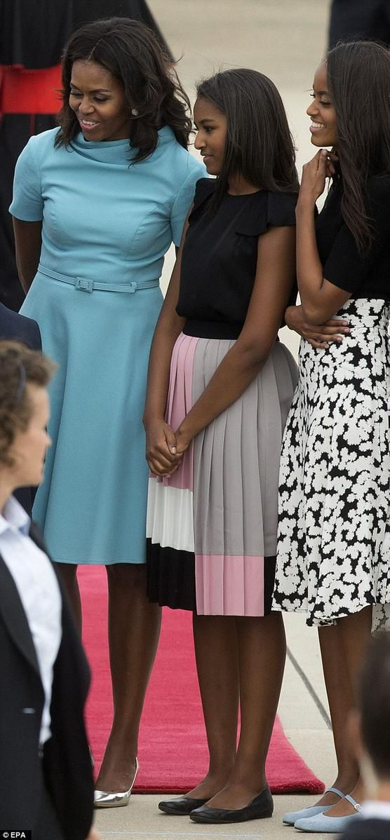 First Lady Michelle Obama and the First daughters Malia and Sasha Obama meeting the Pope
