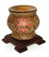 "Asian electric oil warmer measures 6"" tall diameter. Simulated wood stand. Pink cylinder with clear dish for the oil. Uses one 35 watt halogen bulb (included). Oil dish is removal for easy clean up."