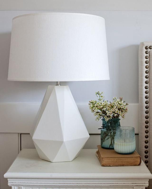 We will be using a lamp to make the room look believable as someone's room. Since most people have lamps on their bedside table, we'd thought we put one there.