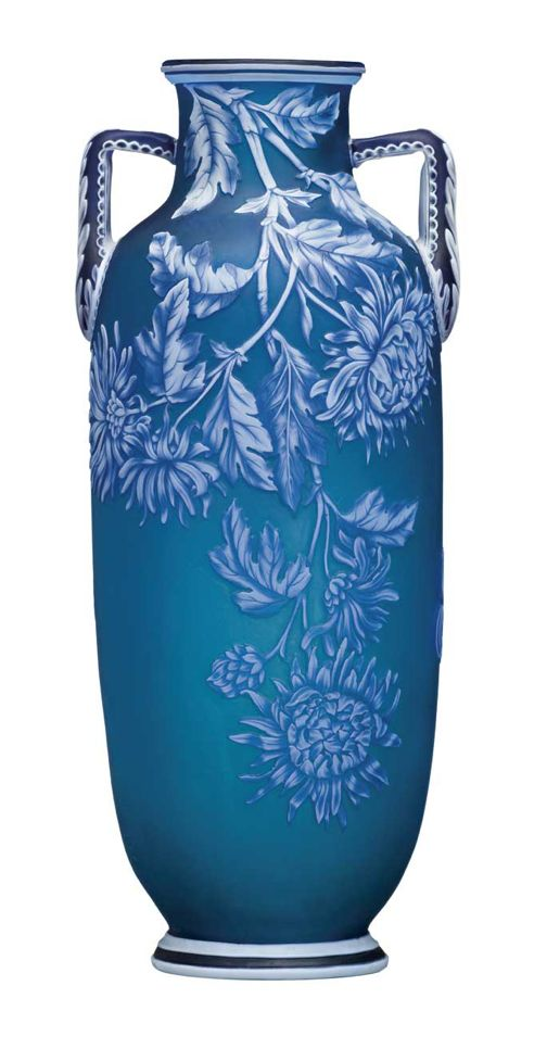 A FINE THOMAS WEBB OVERLAID CAMEO VASE, 19TH CENTURY  of amphora form, the blue body overlaid with dark blue and white and carved with butterflies amongst chrysanthemum, with two upright handles with acanthus